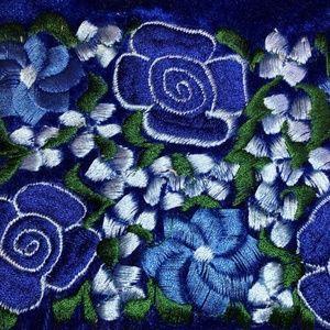 Small bright blue embroidered purse